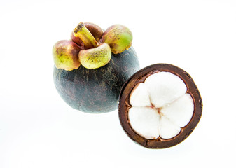 Mangosteen fruit and cross section showing the thick purple skin