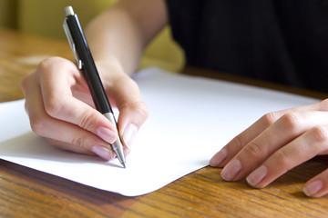 female student writing closeup