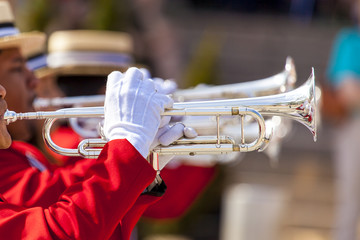 Brass Band in red uniform performing