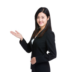 Asian business woman introduce something by hand