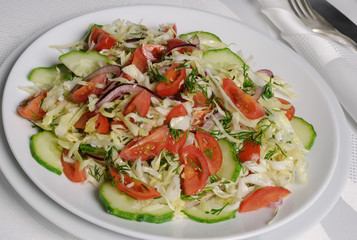 Cabbage salad with cucumber and tomatoes