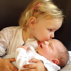Kiss baby brother