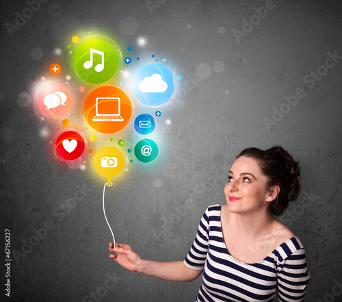 Leinwandbild Motiv Woman holding social media balloon