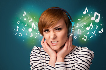 Young woman with headphones listening to music
