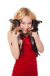 beautiful blonde little girl holding two puppies wearing red dre