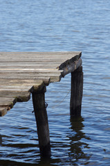 Planked footway on a lake close-up