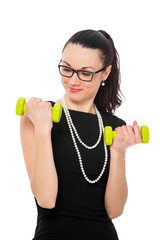 brunette women in black dress holding green dumbbells