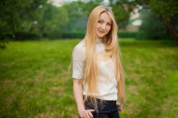 girl out in the park with long blonde hair