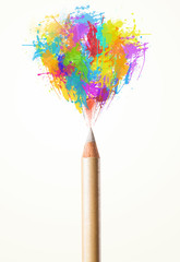 Pencil close-up with colored paint splashes
