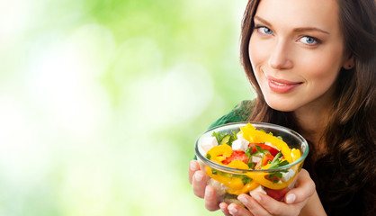 Portrait of smiling woman with plate of salad