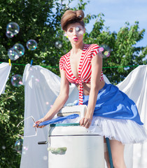 Skirt caught by wringer, pin up woman doing laundry