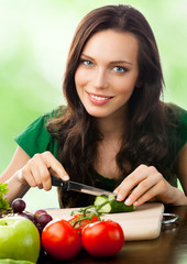 Woman with vegetarian food, outdoor