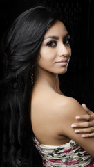 Beautiful young multi-ethnic woman with long dark hair