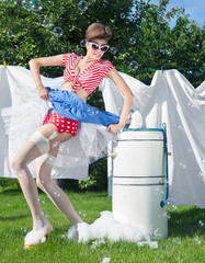 Skirt caught by wringer, funny pin up laundry accident concept