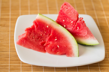 chunky slices of watermelon on a plate