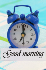 Good morning card with miniature clock showing 7 am
