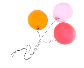 Three balloons isolated over whitebackground with black string