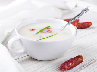 Cheese soup with smoked sausage and chives