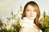 Rromantic escape, beautiful young woman and fairytale castle