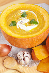 Pumpkin soup served in a pumpkin