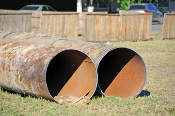Large rusty steel pipe on construction site