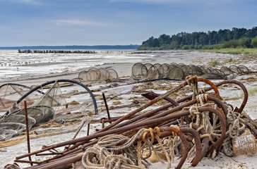 The old fishing anchors at the beach of Baltic sea