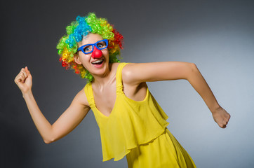 Funny woman in clown dressing