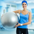 Woman with fitness ball, at gym