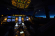 Cockpit of aircraft at sunrise or sunset