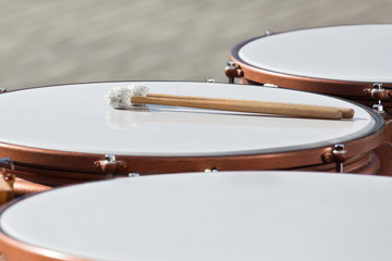 Drumsticks lying on timpani