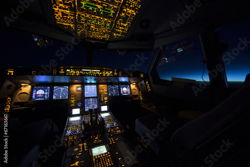 Staande foto Vliegtuig Cockpit of aircraft at sunrise or sunset