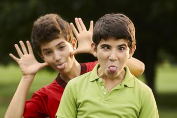 Happy hispanic boys making a grimace at camera
