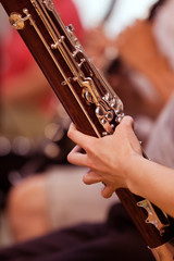 Bassoon in the hands of a musician closeup