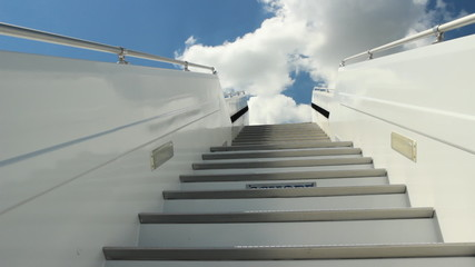White ladder of the plane against the blue sky