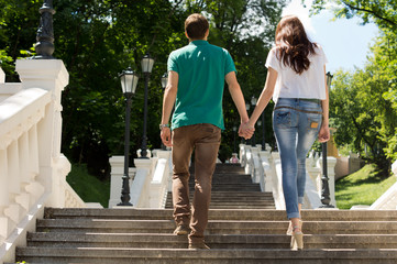 Young couple walking up a flight of steps