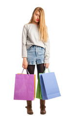 Young stressed woman surrounded by paperbags
