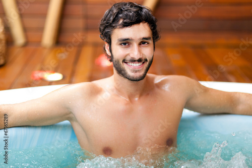 canvas print picture Young man relaxing in a beauty farm