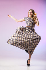 Beautiful  woman in gorgeous dress, motion shot