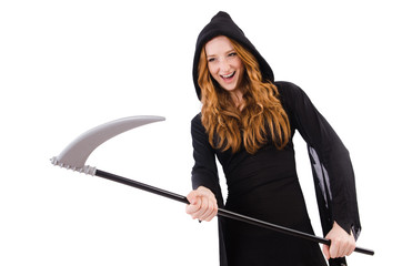 Young witch with scythe isolated on white