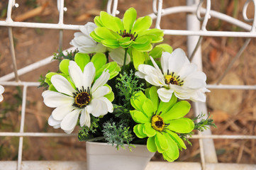 Green and white plastic flowers