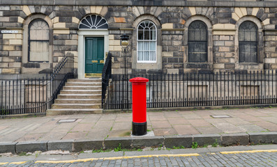 Sidewalk, facades and typical red british postbox