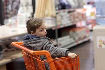 Kid in shopping trolley