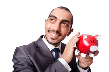 Funny man with piggybank on white