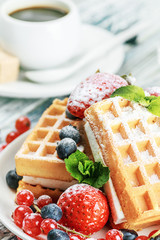Waffles with fresh berries on the table