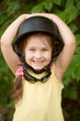 Portrait of smiling child in helmet