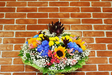 Bright bouquet against the wall