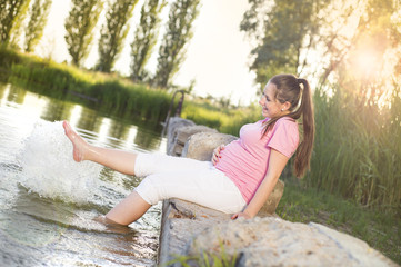 Pregnant woman by the lake