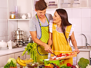 Couple cooking at kitchen.