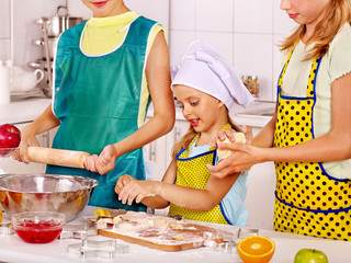 Children bake cookies.