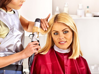 Woman at hairdresser.